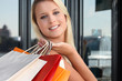 a blonde woman doing shopping