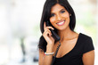 gorgeous young businesswoman answering telephone