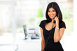 attractive indian businesswoman using telephone