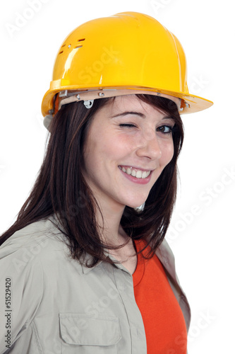 Wink from a female construction worker