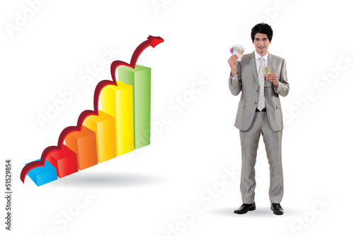 Businessman standing by bar chart holding cash