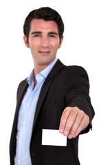 A businessman handing his card.