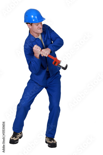 Tradesman using a wrench