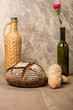 Loaf of fresh rye bread with wine bottle