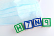 H7N9 alphabet block with protective face mask
