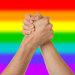Man and woman in arm wrestlin, rainbow flag pattern