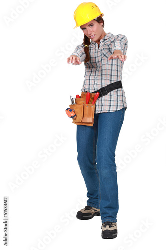 Tradeswoman holding out her arms