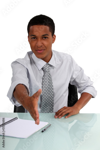 young black executive stretching out his hand to shake hands