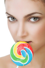 Young girl with a lollipop near her lips