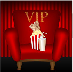 chair and popcorn and a drink on a background of red curtains