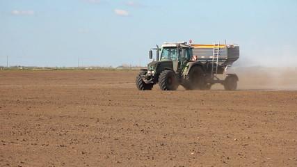 Fertilizer spreader on the field