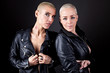 Two beautiful women wearing black leather jacket