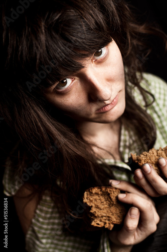 beggar woman with bread