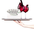 money in envelope on a tray with wine and hand
