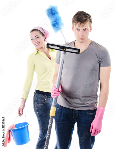 Wife wants to clean the house with irritated man holding vacuum