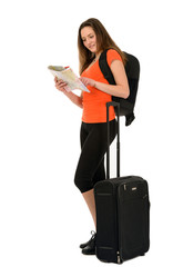 a beautiful woman tourist with a map in hand luggage isolated on