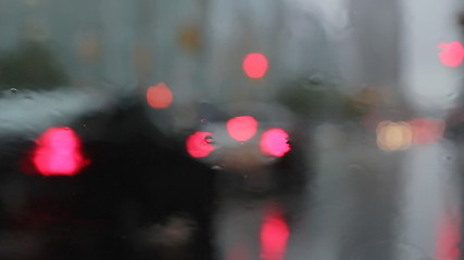 Rainy window with braking traffic. Good rain sounds.