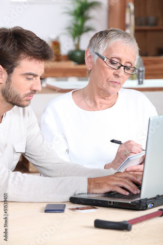 Man helping elderly lady