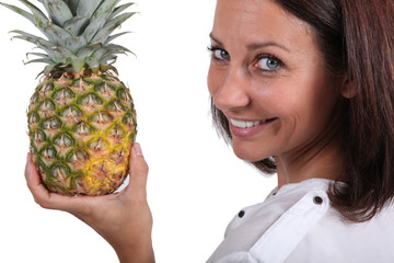 Woman holding fresh pineapple