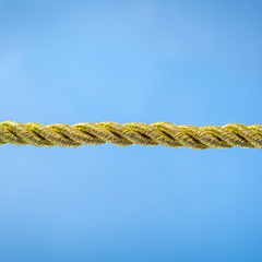 Gold rope on blue