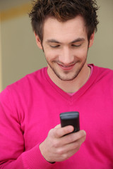 Young man smiling at his phone
