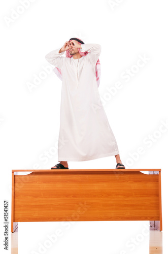 Arab man sitting at his desk