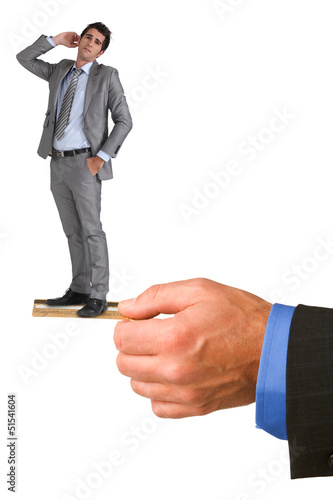 Businessman standing on a credit card