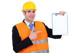 Businessman holding a notepad