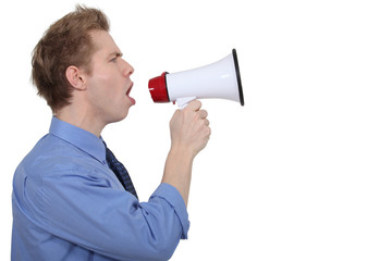 young businessman shouting in loudspeaker