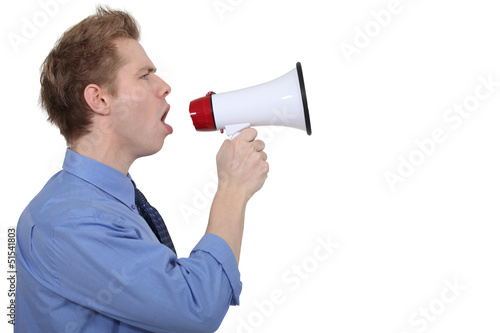young businessman shouting in loudspeaker