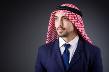 Arab businessman in dark studio