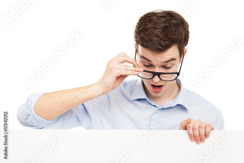 Man in glasses looking at blank sign