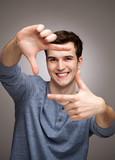 Man forming a finger frame