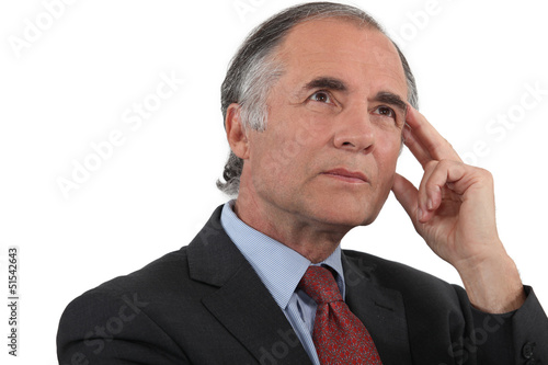 Middle-aged businessman searching for inspiration