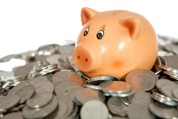 Piggy bank on pile of coins