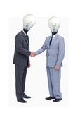 Businessman with light bulb heads greeting with a handshake