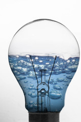 Light bulb and blue water inside