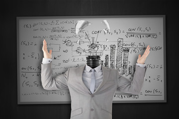 Businessman stressing with light bulb head breaking