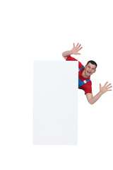 Man leaping from behind blank poster