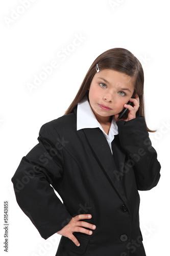 little girl dressed as businesswoman