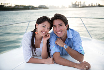 Happy couple in a yacht