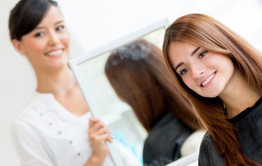 Woman checking her new haircut