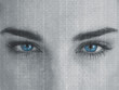 Attractive blue eyed woman with binary code on face
