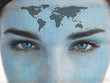 Attractive blue eyed woman with binary coding and map on face