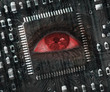 Red eye in middle of black circuit board