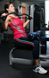 Beautiful woman working out on a trainer