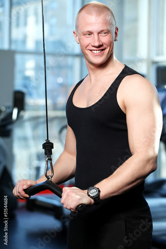 Handsome guy working out in a gym