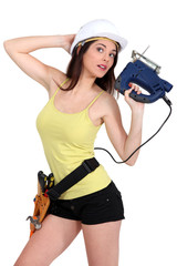Woman holding electric saw