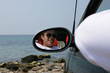 Young man in rearview mirror