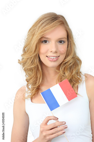 Pretty young woman holding a French flag